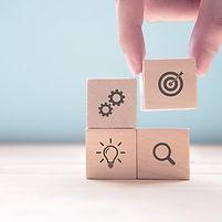 businessman-hand-arranging-wood-block-wi