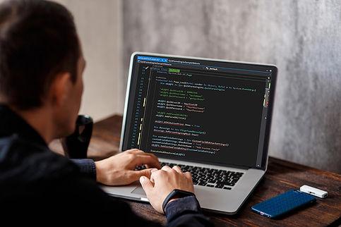 Programmer with Quik Code.jpg