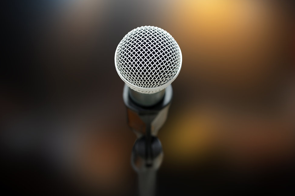Close-up of microphone in concert hall o