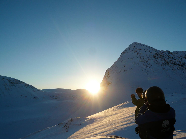 Sun peaking over the mountain