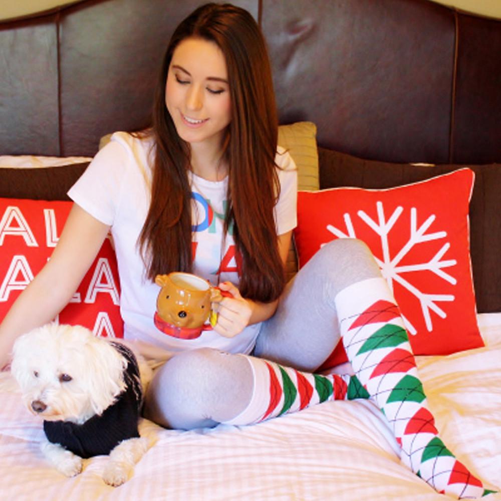 girl in christmas socks