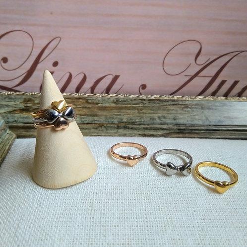 Trio de anillos corazón que forman un Trébol