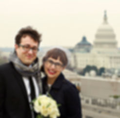 Newlyweds on a rooftop in Washington DC overlooking the U.S. Capitol, photo by Tracey Attlee