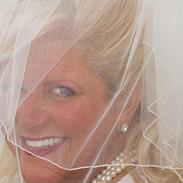 Sparkling blue eyes under a wedding veil, photo Tracey Attlee