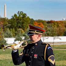 US Army Bugler plays Taps, Arlington Cemetery, photo Tracey Attlee
