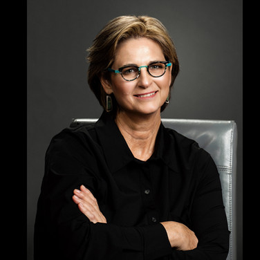 Female CEO environmental business portrait on charcoal backdrop with accent lighting.  Photo by Tracey Attlee