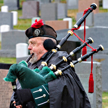 Bagpiper Norm Weaver adds a sentimental touch to military funerals at Arlington Cemetery, photo by Tracey Attlee