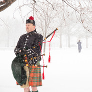 Bagpiper and Bugler in Falling Snow at Arlington Cemetery, photo by Tracey Attlee