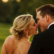 A dusk nuzzle by the bridal couple, balcony, Congressional Country Club, Bethesda, MD photo Tracey Attlee