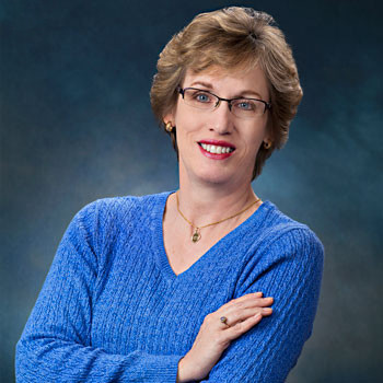 Virginia businesswoman's casual portrait on indigo backdrop by Tracey Attlee