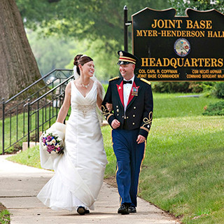 An Army Captain escorts his bride to their reception, Ft. Myer Officer's Club, Arlington, VA photo Tracey Attlee