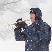 Air Force Bugler in Falling Snow, Arlington Cemetery, photo by Tracey Attlee