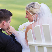 Groom kissing the hand of his Bride, Congressional Country Club, Bethesda, MD photo Tracey Attlee