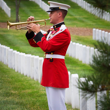 USMC Bugler at a military funeral, Arlington Cemetery, photo by Tracey Attlee
