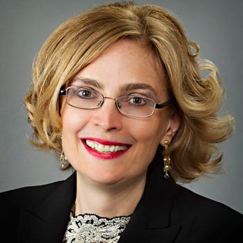 Female DC lawyer's portrait photo on pearl gray backdrop