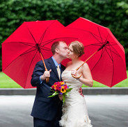 A sweet kiss for the Bride under red umbrellas in the spring rain, The Hirshhorn Sculpture Garden, Washington DC photo Tracey Attlee