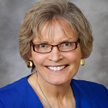 No VA female business owner's portrait on Rembrant backdrop