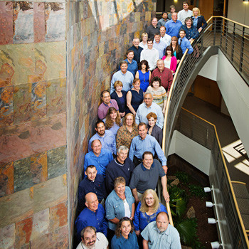 Business group portrait on staircase