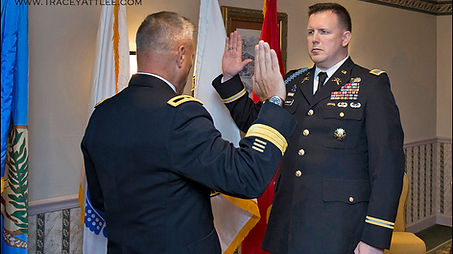 A new Army Colonel is sworn in by his commanding General at a Ft. Myer Promotion Ceremony.   Photo by Tracey Attlee