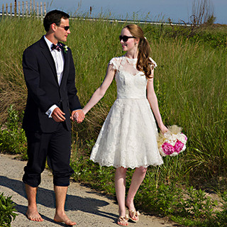 Bridal couple strolling the beachfront, Spring Lake, NJ photo Tracey Attlee