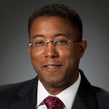 Male DC lawyer's head shot portrait on charcoal backdrop with accent light