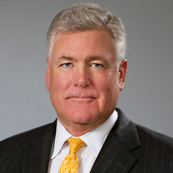 Male executive portrait on pearl gray backdrop