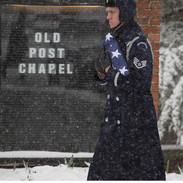 Air Force Honor Guardsman and Flag in Falling Snow photo by Tracey Attlee
