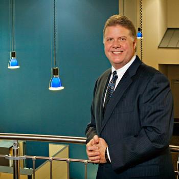 Male corporate executive portrait at company headquarters in Virginia