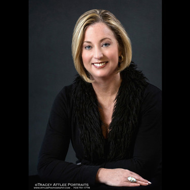 Female executive portrait on black backdrop Photo by Tracey Attlee