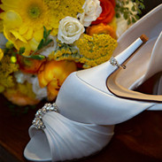 Engagement ring vignette with bride's bouquet and pumps, photo Tracey Attlee