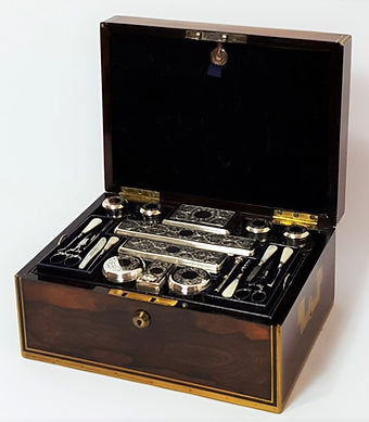 A high quality mid Victorian rosewood dressing and jewelry case with silver and cut glass canisters.
