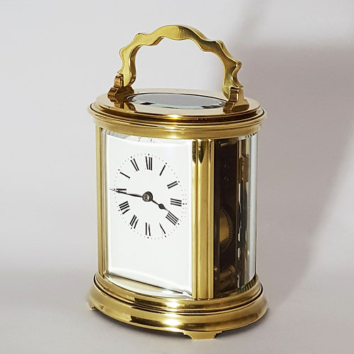French Oval Antique Brass Striking Carriage Clock