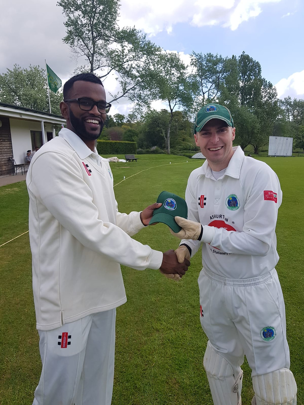 New overseas signing Arun Karthick being presented with his cap by skipper Ashley Berry