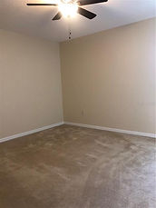 The second bedroom has a ceiling fan, window, and a nice sized closet in this Leesburg Florida rental