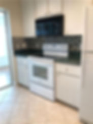 The kitchen features a new stove and dishwasher at this Leesburg apartment rental