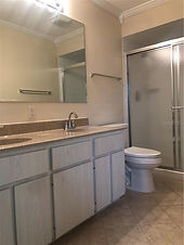 The master bath in this Leesburg rental has a shower, double sink, and commode