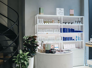 Products on shelves in empty salon - Pho