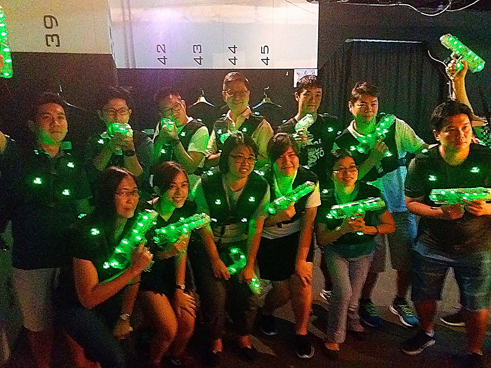 Delegates from Hitachi Singapore posing for a group picture at Siam Laser game center.