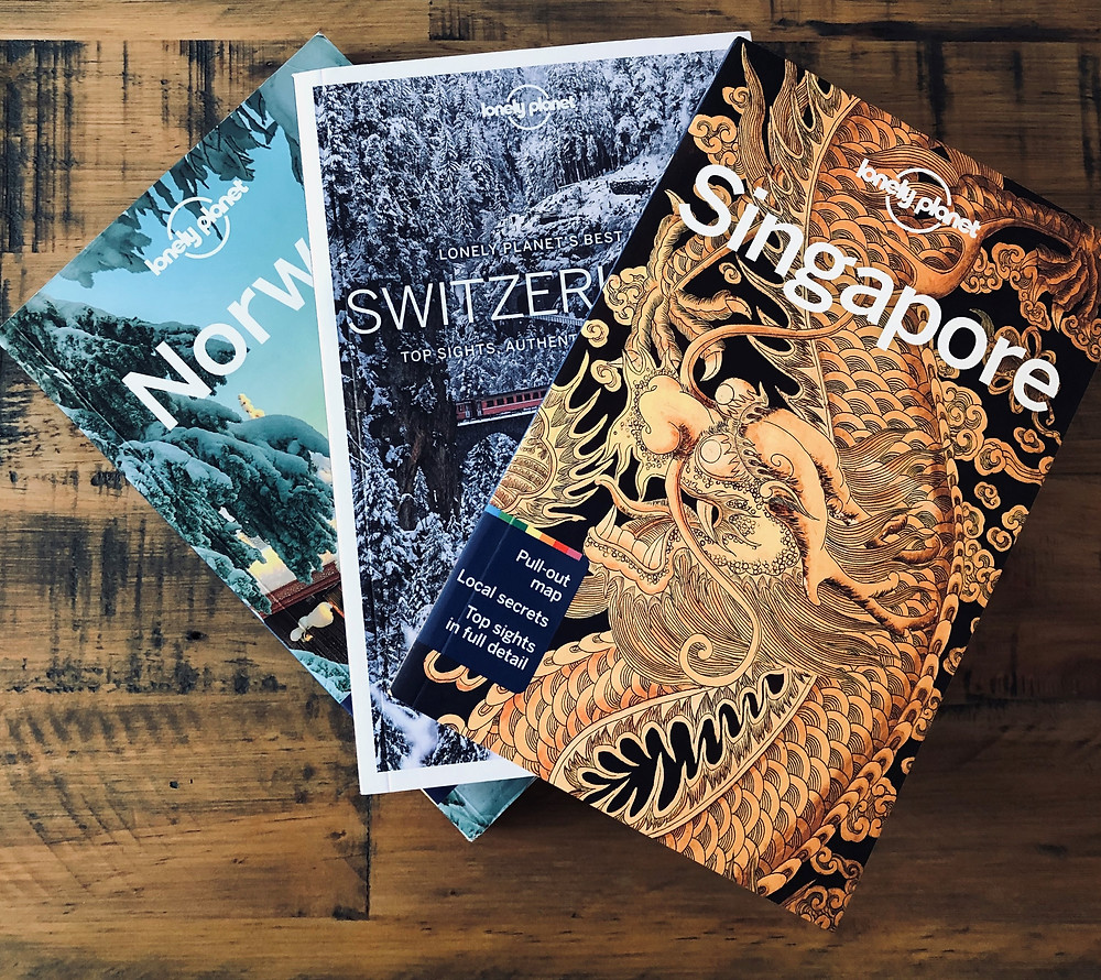 Three guide books for Norway, Switzerland and Singapore
