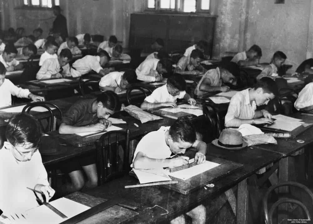A group of children in the 1940s sitting an exam