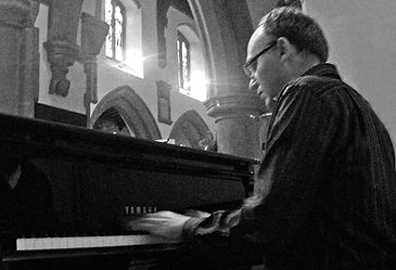 Rob playing Piano 1 cropped b&w screen w