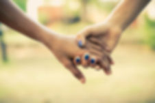 two-people-holding-hands-1101732.jpg