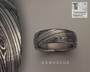 Damascus steel wedding band with titaniu