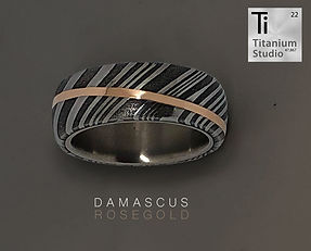 damascus-steel-ring-with-rose-gold-inlay