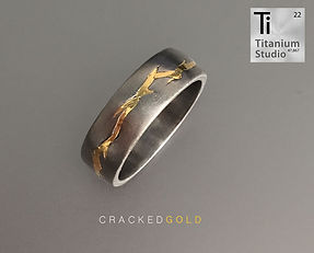 cracked-titanium-ring-with-yellow-gold-i