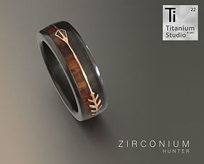 black-zirconium-ring-with-rose-gold-arro