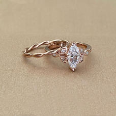 marquise-moissanite-rose-gold-ring-and-b