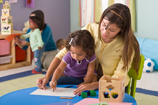 Teacher Helping Student Draw