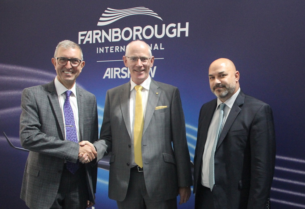 Tom Caffrey, of Lufthansa Technik Shannon (centre) with David George (left) and Todd Skaggs from Brookfield at Farnborough Air Show 2018