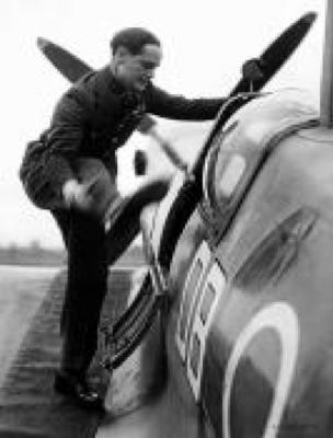 Douglas Bader climbing into his Spitfire.